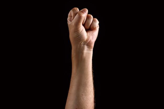Male fist raised up Premium Photo