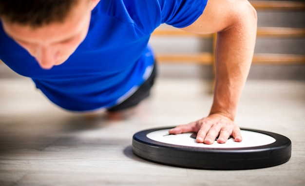 Male at gym pushups exercise Free Photo