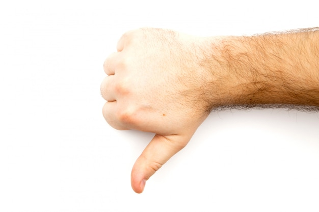 Male hairy hand showing dislike, unlike, fail, disagree sign, thumb down hand with white background and copy space Premium Photo