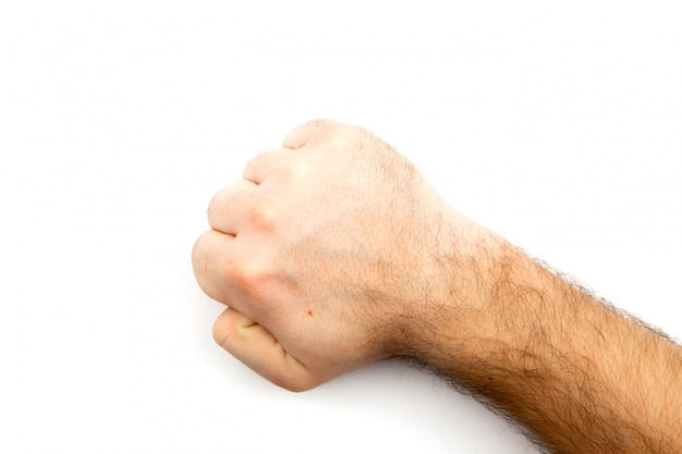 Male hairy hand shows fist that symbolizes danger, crime, blow, fight isolated on white background Premium Photo