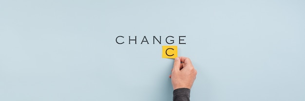 Male hand changing the word change into chance Premium Photo