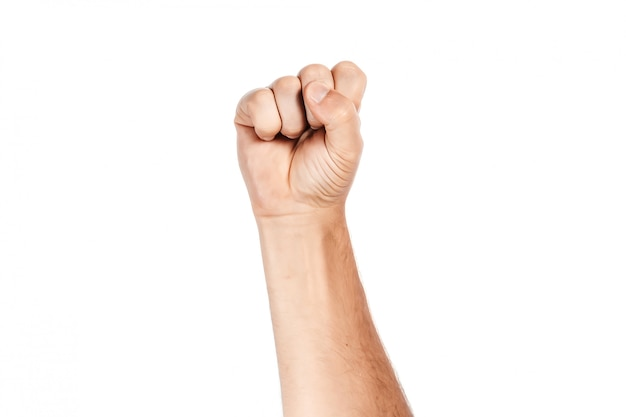 Male hand clenched in fist on white Premium Photo