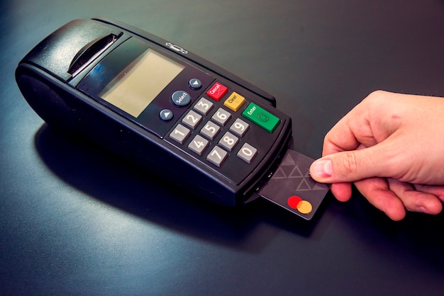 Male hand dials pin code on pin pad of card machine or pos terminal male hand dials pin code on pin pad of card machine or pos terminal with inserted blank white credit card isolated on white background publicscrutiny Gallery