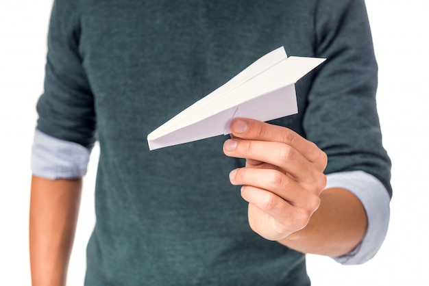Male hand holding a paper plane Premium Photo