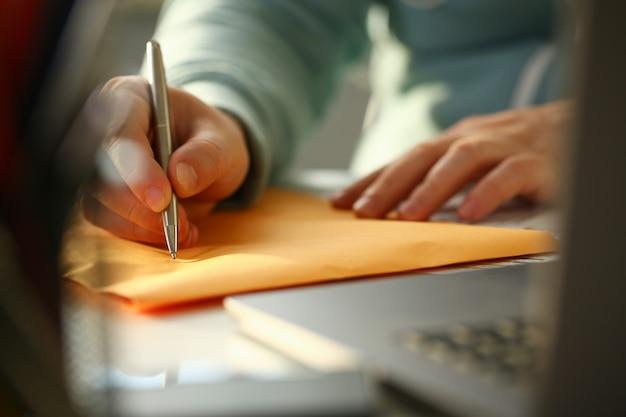 Male hand holding silver pen Premium Photo