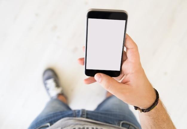Male hand white screen smart phone Premium Photo