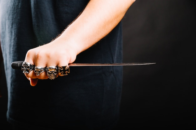 Male hand with sharp dagger Free Photo