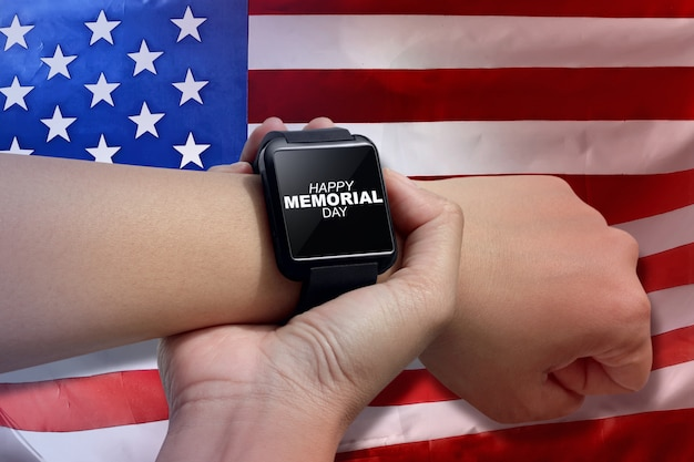 Male hand with smartwatch with text happy memorial day Premium Photo
