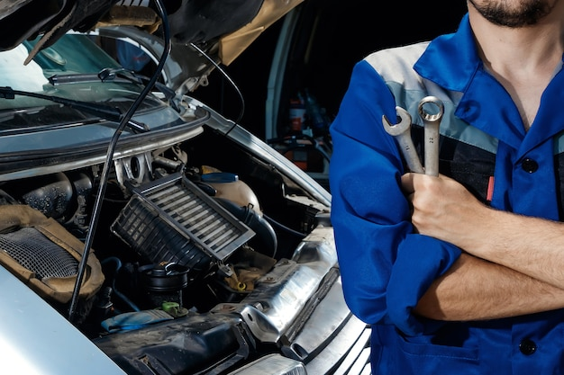 Male hands close-up with wrenches Premium Photo