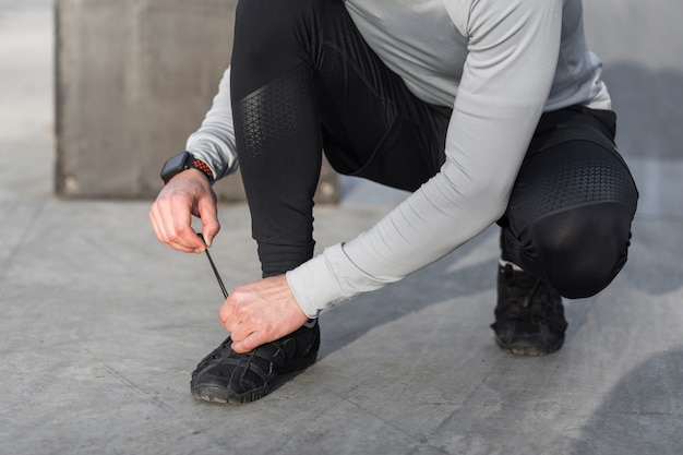 Male hands tying his laces Free Photo