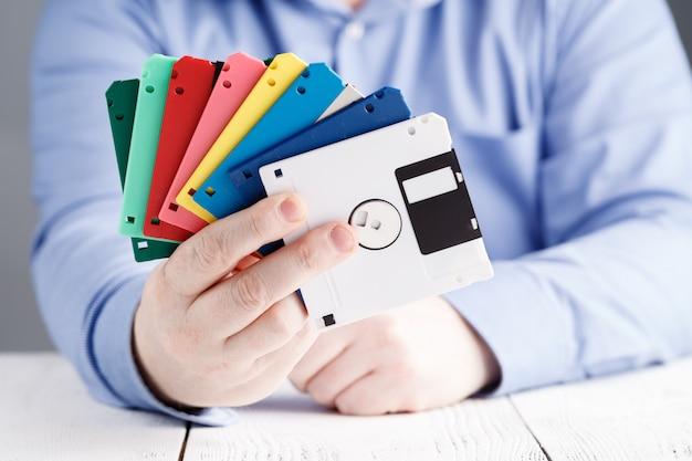 Male hold floppy disk in hands, retro storage Premium Photo