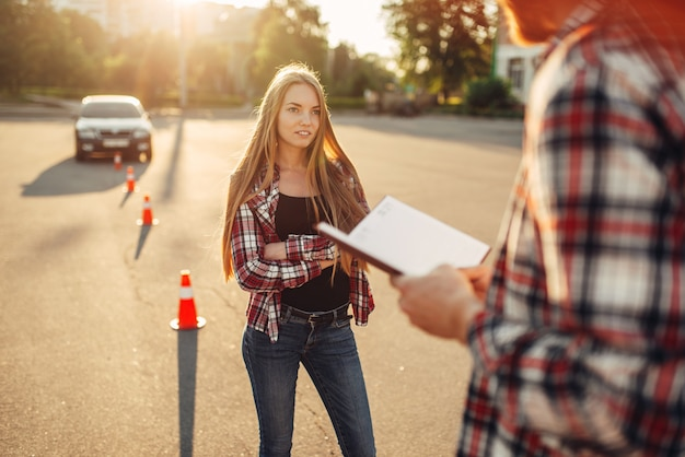 Male instructor and female student, driving school Premium Photo