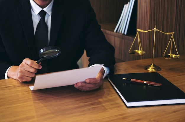 Male lawyer reading legal contract agreement and document Premium Photo