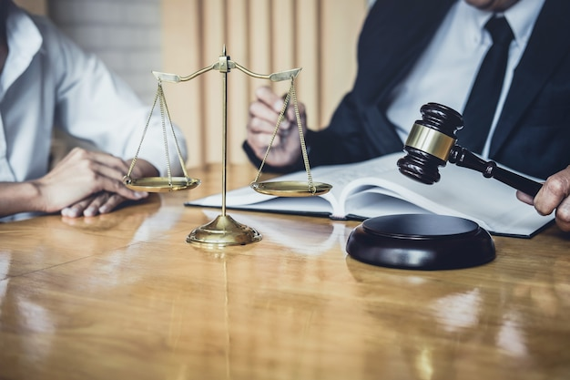 Male lawyer working in courtroom and having meeting with client Premium Photo
