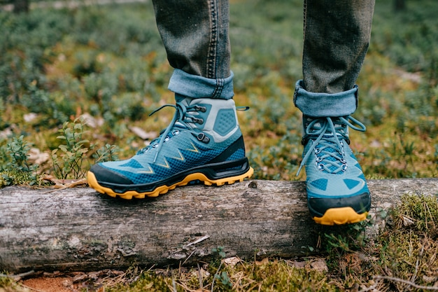 Male legs wearing sportive hiking shoes. mens legs in trekking boots for outdoor activity Premium Photo