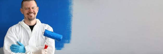 Male painter in uniform with roller in his hand Premium Photo