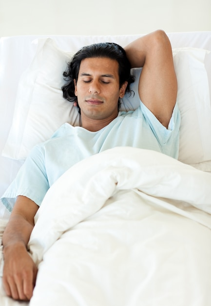 male patient sleeping in a hospital bed photo premium