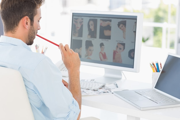 Male photo editor working on computer in office Premium Photo