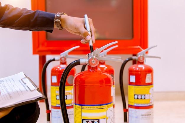 Male professional inspection fire extinguisher Premium Photo