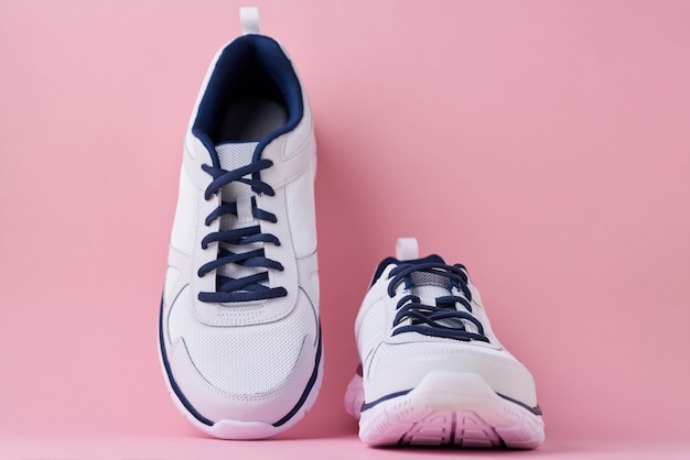 Male sneakers for run on a pink background Premium Photo