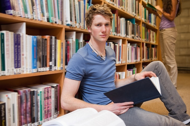 Male student holding a book Premium Photo