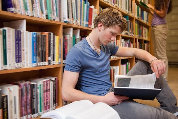 Male student reading a book Premium Photo