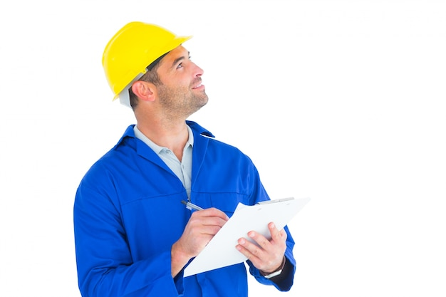 male supervisor looking up while writing on clipboard photo