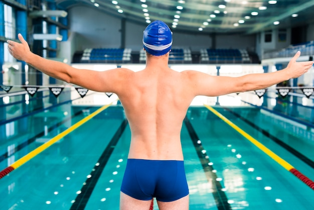 Male swimmer warming up before swimming Free Photo