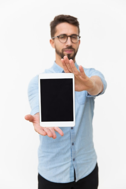 Male tablet user showing blank screen Free Photo