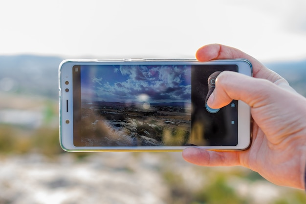 Male tourist is taking photo with mobile phone camera Photo