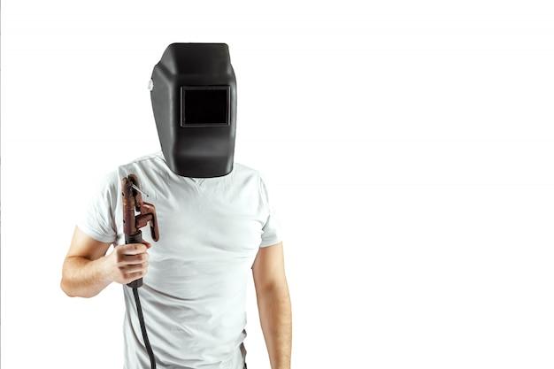 Male welder in a helmet on a white background. Premium Photo