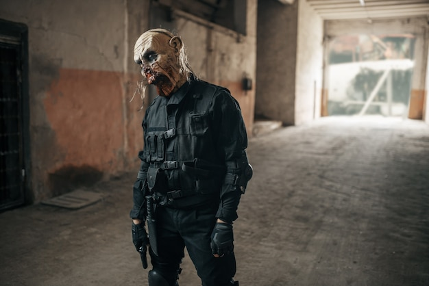 Male zombie walking in abandoned factory Premium Photo