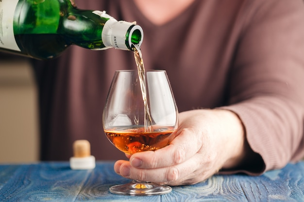 Man abusing alcohol for relaxing, whisky in glass Premium Photo