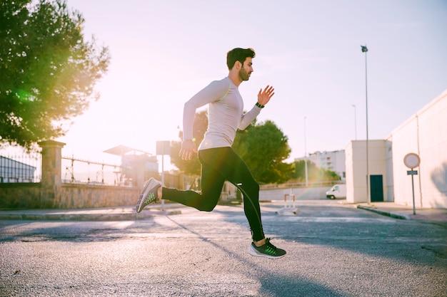 Man actively running on street Free Photo