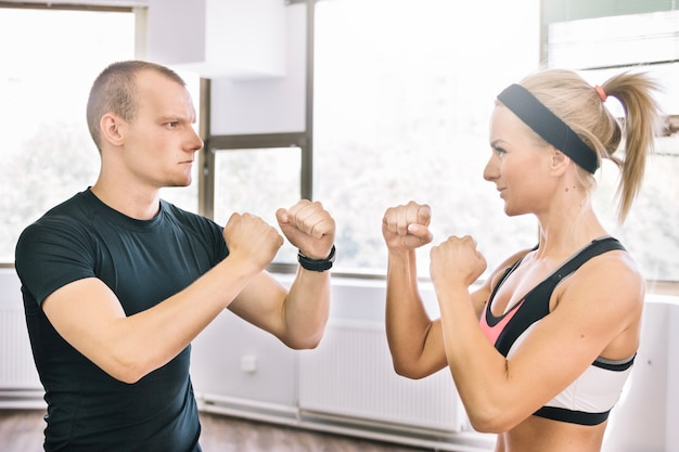 Man and woman in boxing position Free Photo