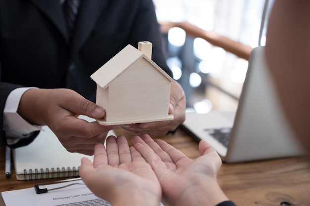 Man applying for mortgage loan with bank employee. Premium Photo
