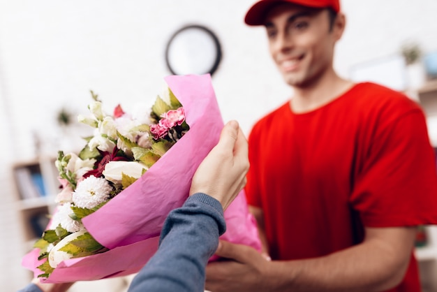 Man of arab nationality works in the delivery of flowers. Premium Photo
