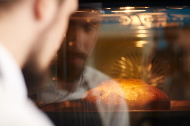 Man baking bread Free Photo