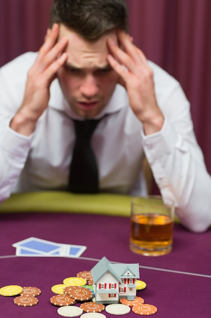 Man betting his house at poker game Premium Photo