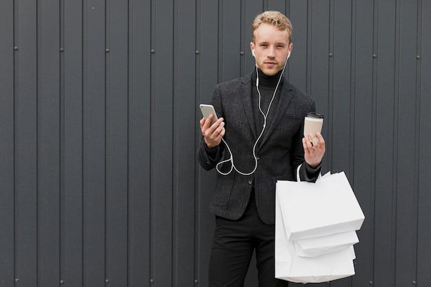 Man in black near a gray wall Free Photo