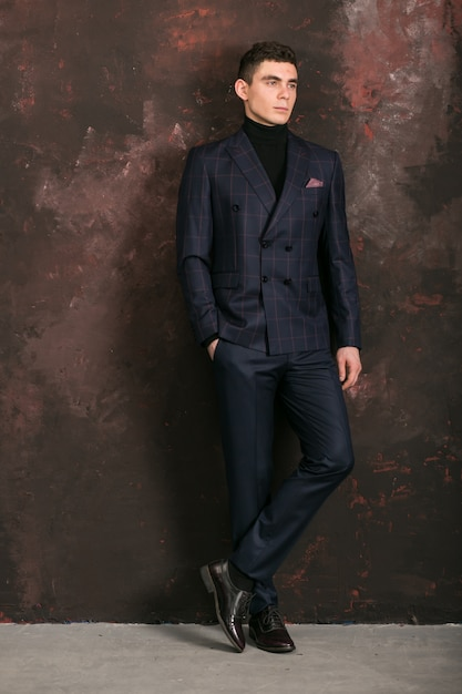 Man in blue suit Free Photo