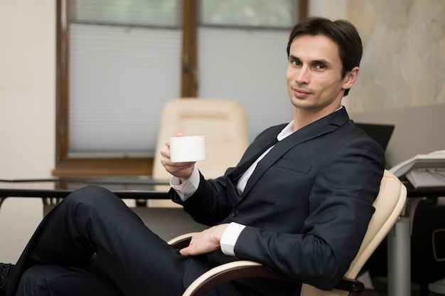 Man on break with coffee mug Free Photo