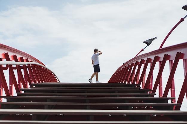 Man on the bridge in amsterdam, python bridge Free Photo