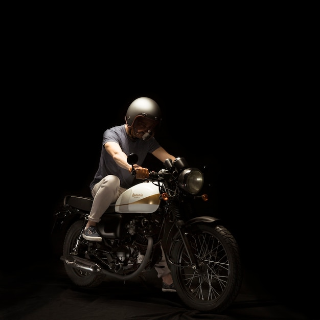 Man on cafe racer style motorbike Free Photo