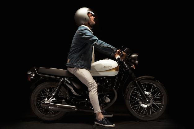Man on cafe racer style motorbike Free Photo