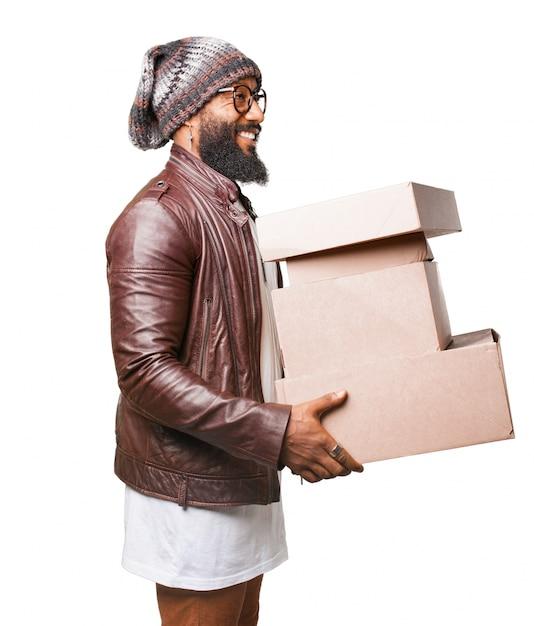 man carrying several cardboard boxes photo free download. Black Bedroom Furniture Sets. Home Design Ideas