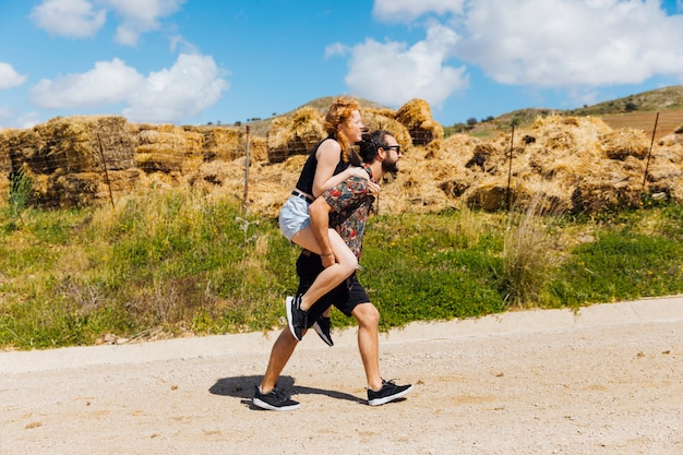 Man carrying woman on back Free Photo