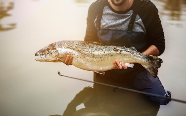 Man caught salmon fish Premium Photo