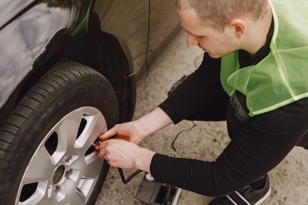 Man changing wheel after a car breakdown Free Photo