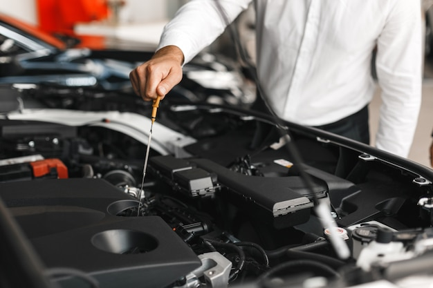 Man checks the presence of oil in the car . close-up male hand Premium Photo